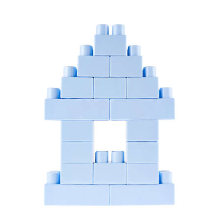 Small home building made of toy construction blue plastic bricks isolated over the white background photo