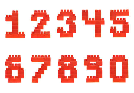 Set of numbers made of red plastic toy construction building bricks isolated over the white background photo