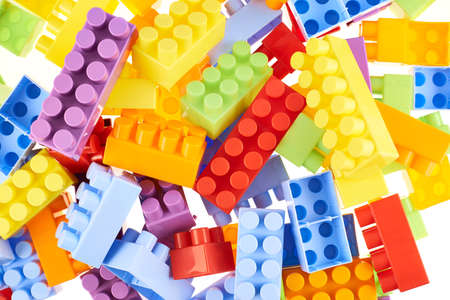 compostion: Pile of colorful plastic toy construction bricks as a background compostion