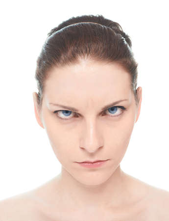sullenly: Young caucasian woman portrait with a concerned, serious and sullenly facial expression, isolated over the white background, natural make up and postprocessing
