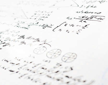 Squared sheet of paper filled with trigonometry math equations and formulas as a background composition with the shallow depth of field Stock Photo