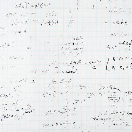 Squared sheet of paper filled with partially erased trigonometry math equations and formulas as a background composition photo