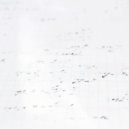 trigonometry: Squared sheet of paper filled with partially erased trigonometry math equations and formulas as a background composition with a shallow depth of field