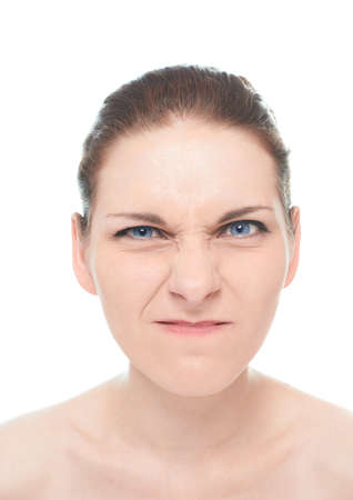 aversion: Young caucasian woman portrait with an aversion and disgust facial expression, isolated over the white background, natural make up and postprocessing