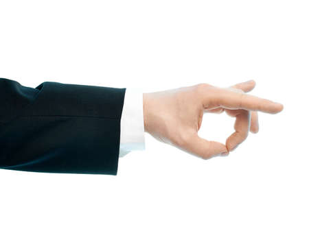 Dressed in a business suit caucasian male hand gesture of an okay approval sign, high-key light composition isolated over the white background photo