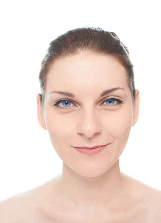 Young caucasian woman portrait with a sly half smile positive facial expression, isolated over the white background, natural make up and postprocessing photo