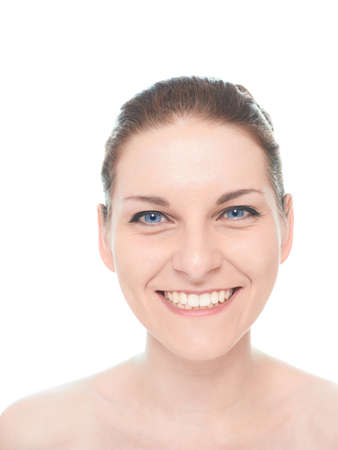 widely: Young caucasian woman portrait with a happy and widely smiling facial expression, isolated over the white background, natural make up and postprocessing Stock Photo