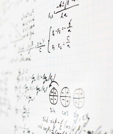 trigonometry: Squared sheet of paper filled with trigonometry math equations and formulas as a background composition with the shallow depth of field Stock Photo