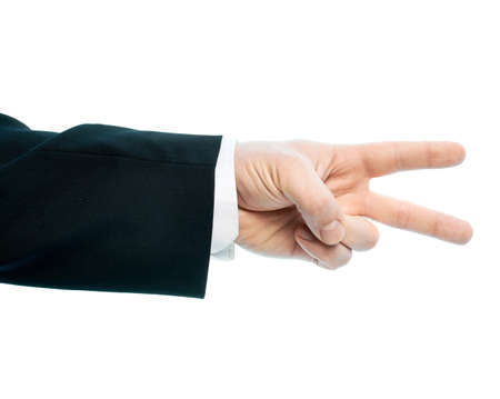 Dressed in a business suit caucasian male hand gesture of a two fingers victory sign, high-key light composition isolated over the white background photo
