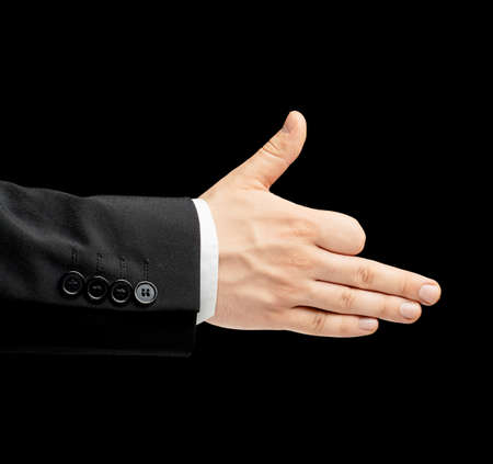 lowkey: Caucasian male hand in a business suit, showing the dog gesture sign, low-key lighting composition, isolated over the black background Stock Photo