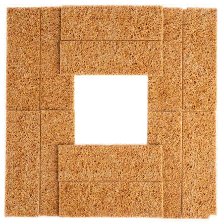 Copyspace empty square frame made of bread cracker snacks as a background composition photo