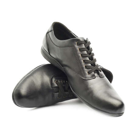 Composition of two classic black leather shoes isolated over the white background photo