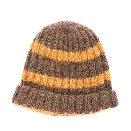Brown knitted head cap with the orange stripes, isolated over the white background photo