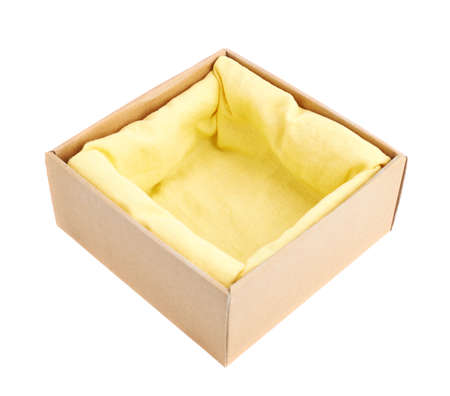 packer: Opened cardboard box with the yellow cloth inside, isolated over the white background