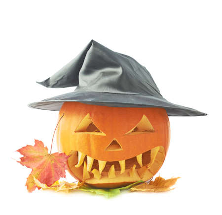 cone shaped: Jack-o-lanterns orange pumpkin head in a black pointed cone shaped wizards hat over a pile of colorful maple leaves, composition isolated over the white background