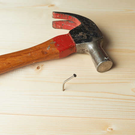 failed attempt: Composition of the hammer and improperly hammered and bent nail Stock Photo