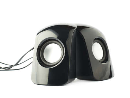 Pair of black glossy sound speakers isolated over the white background photo