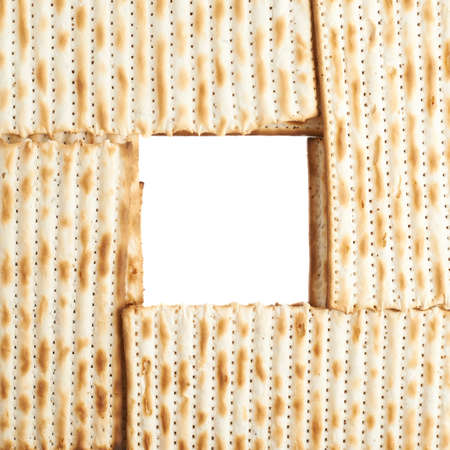 matza: Square frame formed with machine made matza flatbread as a background composition