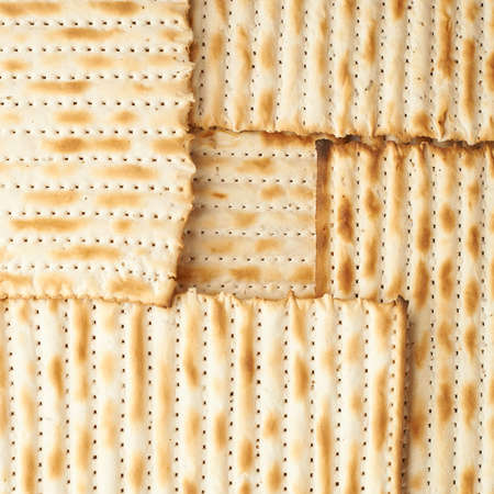 machine made: Surface covered with machine made matza flatbread as a background texture composition