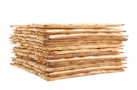 matza: Pile of machine made matza flatbread, composition isolated over the white background