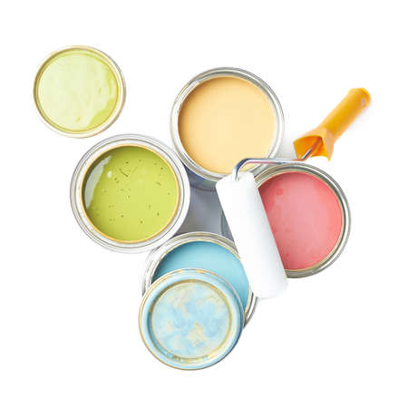 Paint roller over the opened cans of paint, top view above foreshortenings, composition isolated over the white background