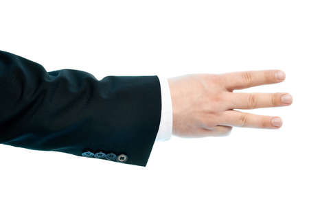 Dressed in a business suit caucasian male hand gesture of a number three sign, high-key light composition isolated over the white background photo