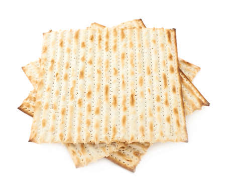 Twisted pile of multiple machine made matza flatbreads, composition isolated over the white background photo