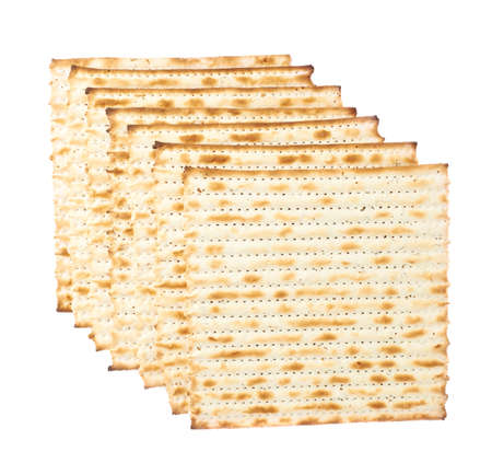 jewry: Multiple machine made matza flatbreads lying one over another, composition isolated over the white background