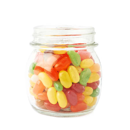 Jar full of jelly bean candy sweets, composition isolated over the white background photo