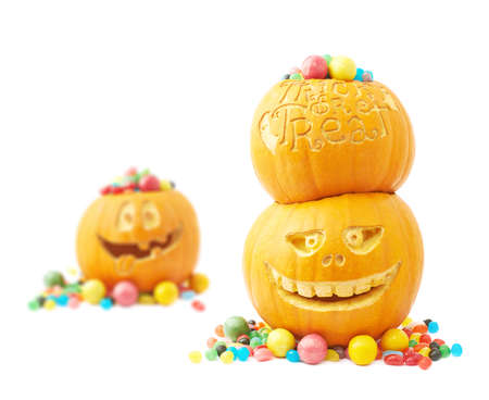Halloween pumpkin filled with multiple colorful sweets and candies composition, isolated over the white background photo