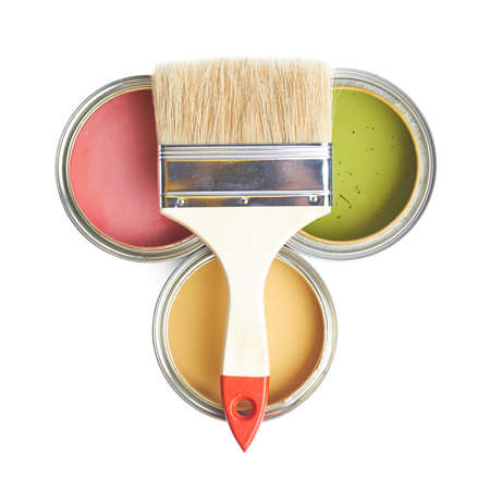 Wide brush over three cans of paint, top view above foreshortening, composition isolated over the white background photo