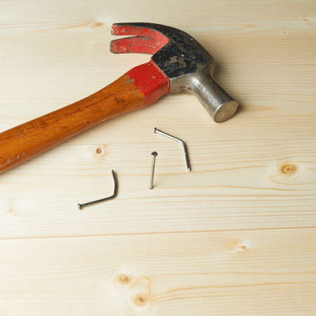 attempts: Hammering the nail to the wooden boards after the two failed attempts