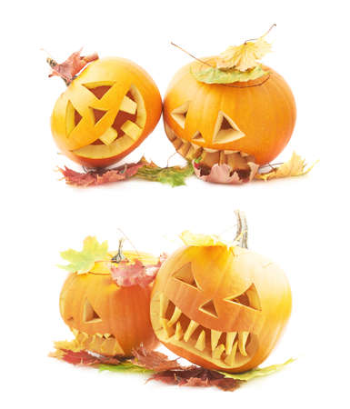 Two Jack-o-lanterns orange pumpkin heads placed one next to another, both covered with colorful maple leaves, composition isolated over the white background, set of two foreshortenings photo