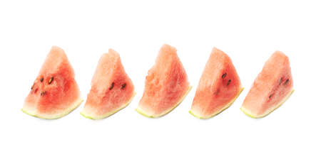 triangle shaped: Lined up triangle shaped watermelon pieces composition, isolated over the white background