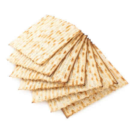 machine made: Twisted pile of multiple machine made matza flatbreads, composition isolated over the white background Stock Photo