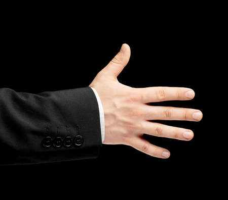 Caucasian male hand in a business suit, opened five fingers palm gesture sign, low-key lighting composition, isolated over the black background photo