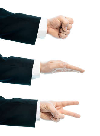 Dressed in a business suit caucasian male hand composition, set of rock, paper, scissors gestures, high-key light composition isolated over the white background photo