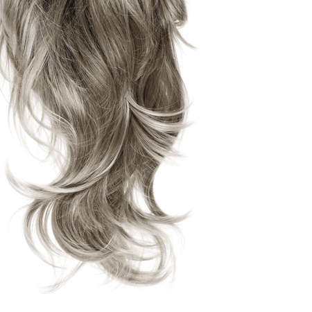 Curly hair fragment placed over the white background as a copyspace backdrop composition Фото со стока