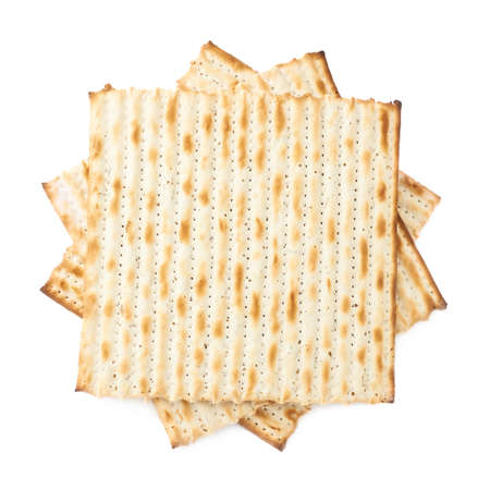 machine made: Twisted pile of multiple machine made matza flatbreads, composition isolated over the white background, top view above