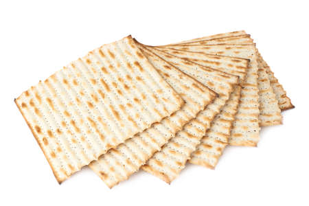 Twisted pile of multiple machine made matza flatbreads, composition isolated over the white background Stock Photo