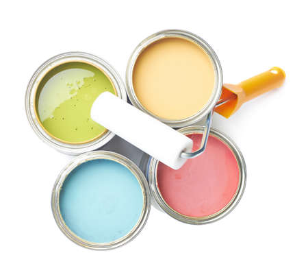 Paint roller over the opened cans of paint, top view above foreshortening, composition isolated over the white background