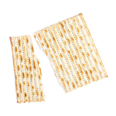 Cracked in two pieces machine made matza flatbread, composition isolated over the white background