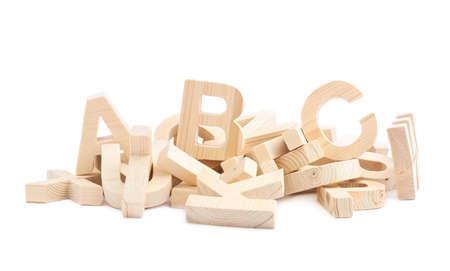 Stapel van meerdere houten blok letters geïsoleerd over de witte achtergrond Stockfoto