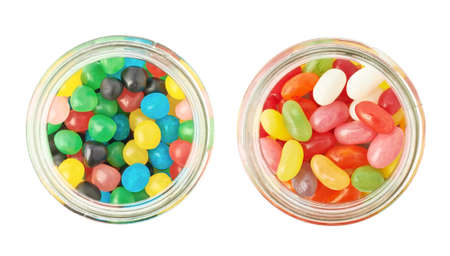 Two jars full of different kinds of candies, isolated over the white background, top view above foreshortening photo
