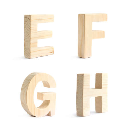 Set of four wooden block character E, F, G, H symbols, isolated over the white background photo