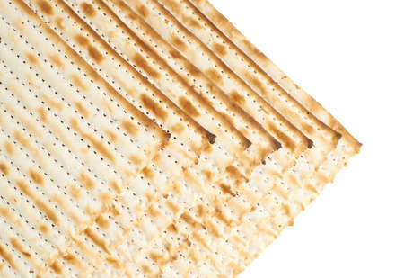Multiple machine made matza flatbreads lying one over another as a background composition photo