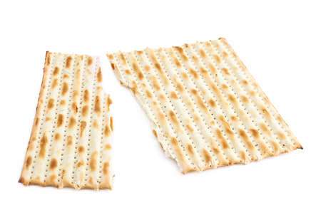 machine made: Cracked in two pieces machine made matza flatbread, composition isolated over the white background