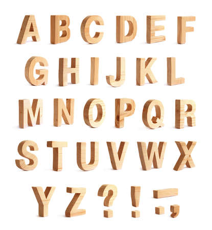 abc: Brown varnished wooden ABC alphabet set with punctuation marks, composition isolated over the white background