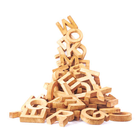 Pile of wooden block letters isolated over the white background as a typography background composition Banque d'images