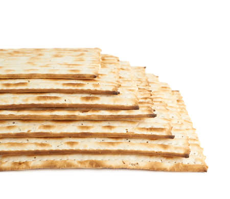 jewry: Multiple machine made matza flatbreads lying one over another as a background composition